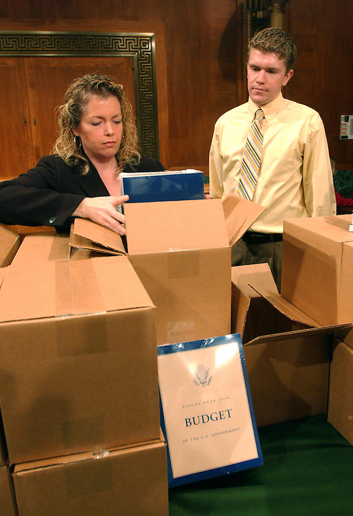 02/07/05.PRESIDENT'S BUDGET PROPOSAL DELIVERED TO CAPITOL HILL--Senate Budget staffers Sarah Kuehl and Matt Havlik get copies of President Bush's $2.5 trillion fiscal 2006  just-delivered budget proposal at the Senate Budget Committee meeting room in the Dirksen Senate Office Building..CONGRESSIONAL QUARTERLY PHOTO BY SCOTT J. FERRELL