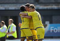 Torquay United's Joe Quigley (centre) celebrates scoring the opening goal