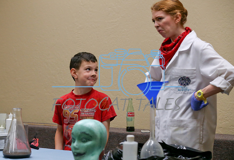 Logan Williams, 6, helps Radioactive Rachel with an experiment during the Mad Science program at the Carson City Library, in Carson City, Nev., on Tuesday, July 15, 2014.<br /> Photo by Cathleen Allison