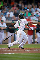 Dayton Dragons shortstop Hector Vargas (7) follows through on a swing during a game against the Cedar Rapids Kernels on May 10, 2017 at Fifth Third Field in Dayton, Ohio.  Cedar Rapids defeated Dayton 6-5 in ten innings.  (Mike Janes/Four Seam Images)