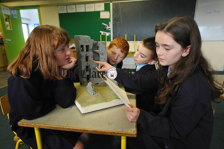 Aisling Nagle, Oisin Leyden, Ben Kenneally and Emma Lucas looking at a scale model of the local castle at Liscannor NS. Photograph by John Kelly.