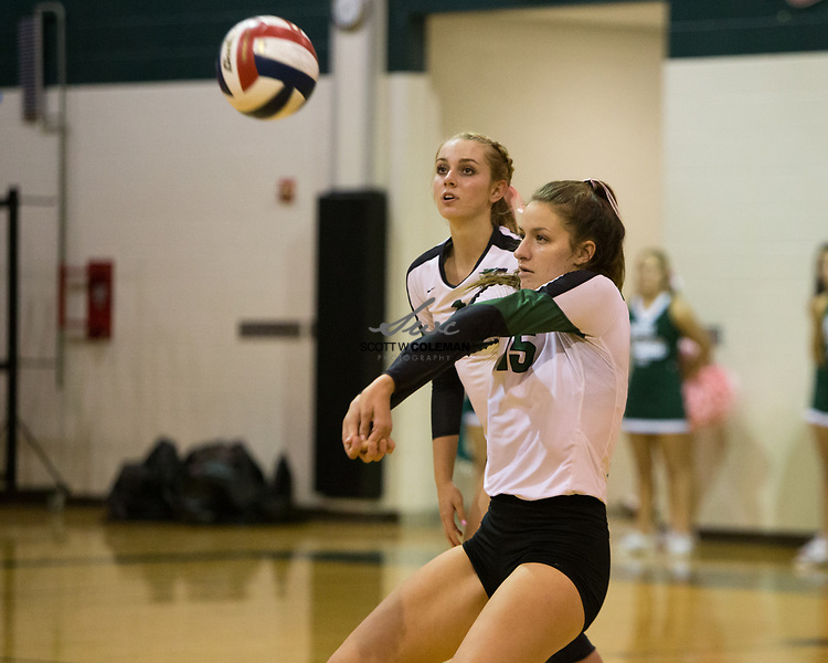 Cedar Park Timberwolves junior Ryan Kaharski (1) and senior Shelby Motz (15) during the high school volleyball game between Cedar Park and Elgin at Cedar Park High School in Cedar Park, Texas, on October 3, 2017.