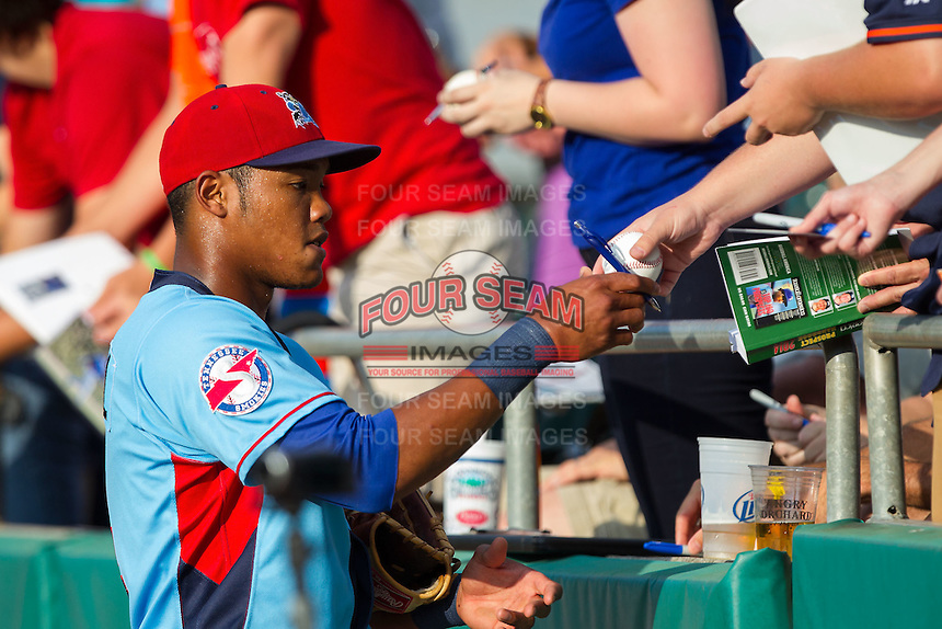 Tennessee Smokies shortstop Addison Russell (4) signs autographs prior to the game against the Mississippi Braves at Smokies Park on July 22, 2014 in Kodak, Tennessee.  The Smokies defeated the Braves 8-7 in 10 innings. (Brian Westerholt/Four Seam Images)
