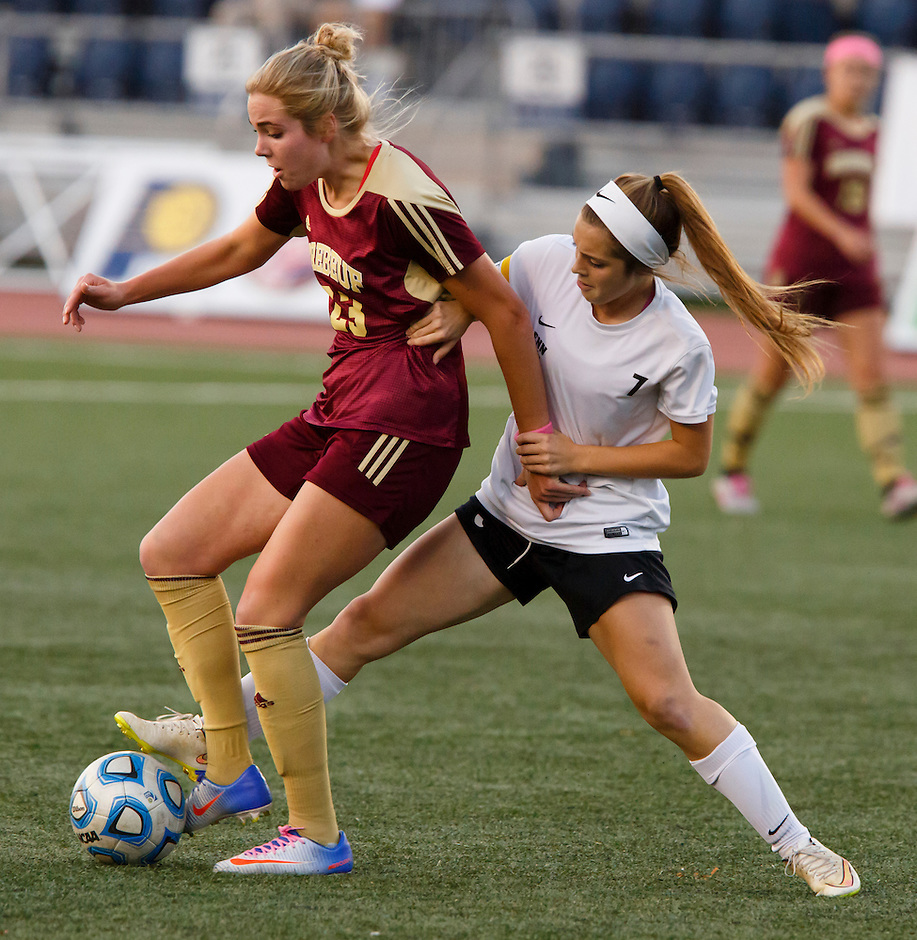 Penn's Brooke VanDyck (7) and Brebeuf Jesuit's Alia Martin (23) compete for the ball during the IHSAA Class 2A Girls Soccer State Championship Game on Saturday, Oct. 29, 2016, at Carroll Stadium in Indianapolis. Special to the Tribune/JAMES BROSHER