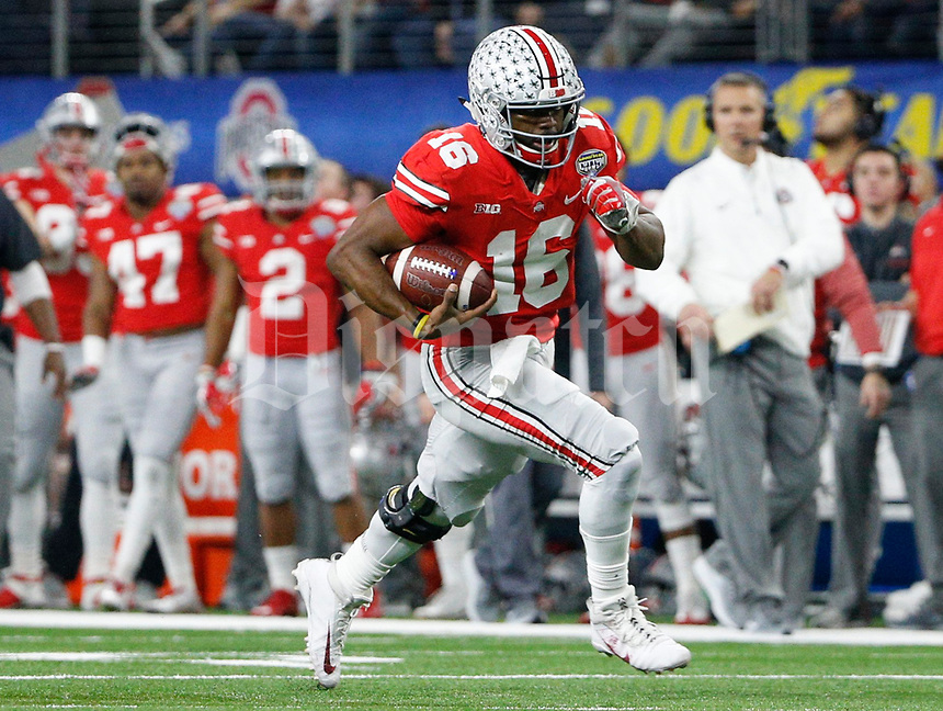 Ohio State Buckeyes quarterback J.T. Barrett (16) races for the end zone for a 28-yard touchdown during the second quarter of the Goodyear Cotton Bowl Classic between the Ohio State Buckeyes and the USC Trojans on Friday, December 29, 2017 at AT&T Stadium in Arlington, Texas. [Joshua A. Bickel/Dispatch]