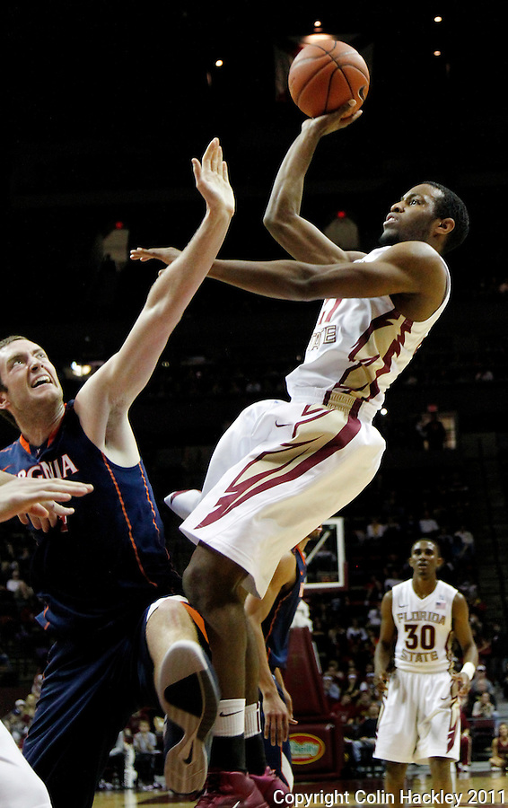 TALLAHASSEE, FL 10-FSU-VA MBB11 CH-Florida State's  Michael Snaer shoots over Virginia's Will Regan during first half action Saturday at the Donald L. Tucker Center in Tallahassee...COLIN HACKLEY PHOTO