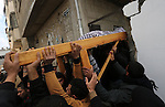 Palestinian mourners carry the body of Ishaq Hassan, 28, who was shot dead by Egyptian border guards as he crossed from the Gaza Strip into Egypt, during his funeral in Gaza city on December 31, 2015. Ishaq Hassan, who was said to suffer from mental illness, was shot dead after he crossed naked the posts and fencing marking the border between the Palestinian enclave and Egypt. Photo by Mohammed Asad