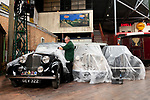 Pictured: Museum attendant Colin Stewart removes the dust cover on a 1938 Rover 14 car on display at the National Motor Museum, Beaulieu in Hants. <br /> <br /> The museum opens its doors for the first time to vistors tomorrow, Saturday 4th July or  'Super Saturday' following the governments easing of lockdown restrictions as pubs, barbers and museums reopen nationwide. <br /> <br /> Visitors are able to book tickets to the attraction online, and will have to follow social distancing measures around the museum. <br /> <br /> © Jordan Pettitt/Solent News & Photo Agency<br /> UK +44 (0) 2380 458800