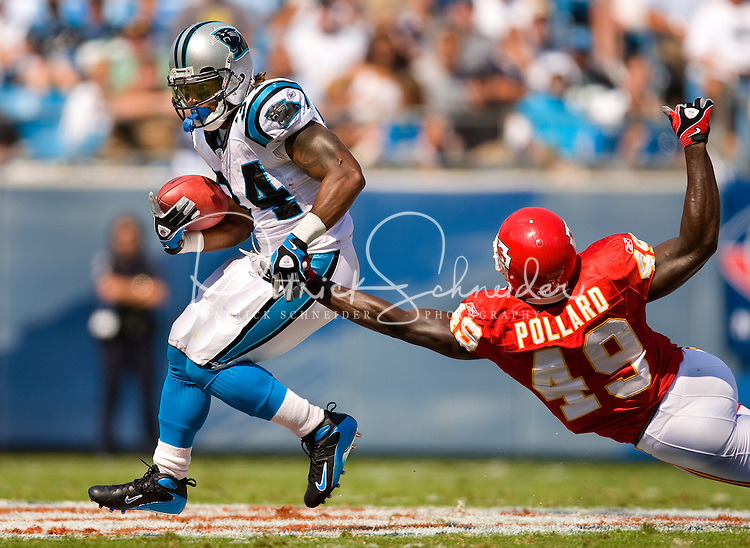 Carolina Panthers running back DeAngelo Williams (34) runs the ball against Kansas City Chiefs SS Bernard Pollard (49) during a NFL football game at Bank of America Stadium in Charlotte, NC.