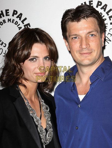 "STANA KATIC & NATHAN FILLION .An Evening with ""Castle"" Presented by The Paley Center for Media held at The Paley Center, Beverly Hills, California, USA, 16th March 2010..half length jacket blazer  blue shirt   black silver chain necklace.CAP/ADM/KB.©Kevan Brooks/Admedia/Capital Pictures"