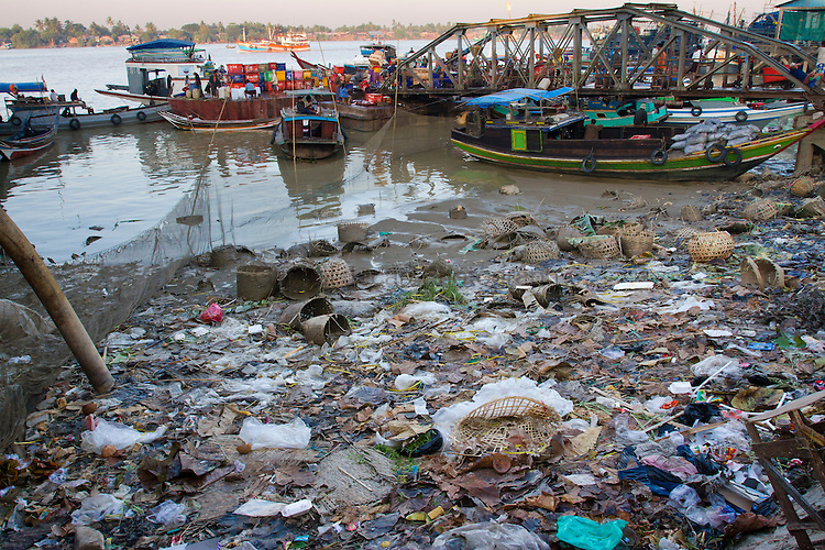 Trash impact on the river edge in Yangon