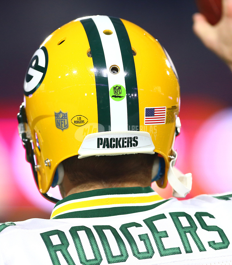 Jan 16, 2016; Glendale, AZ, USA; Detailed view of the green audio enabled sticker on the helmet of Green Bay Packers quarterback Aaron Rodgers (12) against the Arizona Cardinals in the first quarter of a NFC Divisional round playoff game at University of Phoenix Stadium. Mandatory Credit: Mark J. Rebilas-USA TODAY Sports