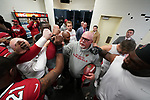 Arizona Cardinals head coach Bruce Arians leads the postgame huddle for the last time after an NFL football game.