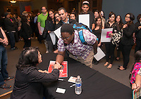 Enoch Sowah '14 meets longtime labor leader Dolores Huerta, 81, after she spoke at Occidental College's Thorne Hall on March 25, 2014.<br /> (Photo by Marc Campos, Occidental College Photographer)