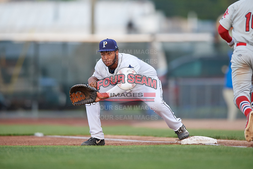Princeton Rays first baseman Vincent Byrd (24) waits to receive a throw as Luis Flores (16) runs up the first base line during the second game of a doubleheader against the Johnson City Cardinals on August 17, 2018 at Hunnicutt Field in Princeton, Virginia.  Princeton defeated Johnson City 12-1.  (Mike Janes/Four Seam Images)