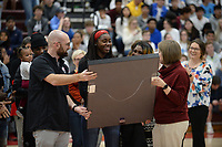 Former Springdale standout and current Arkansas guard Marquesha Davis is presented a framed jersey Tuesday, Feb. 11, 2020, by coach Heather Hunsucker (right) as her jersey is retired during halftime of the boys game with Har-Ber in Bulldog Arena in Springdale. Visit nwaonline.com/prepbball/ for a gallery from the games.<br /> (NWA Democrat-Gazette/Andy Shupe)