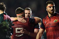 Brian Scott of Munster Rugby embraces team-mate Billy Holland in celebration at the final whistle. European Rugby Champions Cup match, between Leicester Tigers and Munster Rugby on December 17, 2017 at Welford Road in Leicester, England. Photo by: Patrick Khachfe / JMP