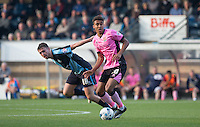 Dominic Calvert-Lewin of Northampton Town on the ball under pressure from Dan Rowe of Wycombe Wanderers during the Sky Bet League 2 match between Wycombe Wanderers and Northampton Town at Adams Park, High Wycombe, England on 3 October 2015. Photo by Andy Rowland.