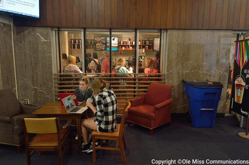 Students make use of the Starbucks J.D. Williams library during the last week of classes before finals.  Photo by Kevin Bain/Ole Miss Communications