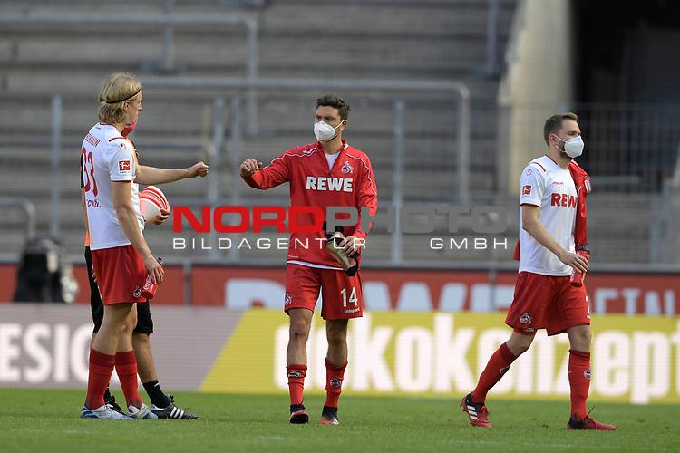 nph00351: v.li:Sebastian BORNAUW  (1.FC Koeln),<br /> Jonas HECTOR (1.FC Koeln),<br /> Jorge MERE  (1.FC Koeln)<br /> nach Spielende.Sie tragen Mundschutz,Masken.<br /> Sport: Fussball: 1. Bundesliga: Saison 19/20: 26.Spieltag: 1.FC KOELN-FSV MAINZ 05,17.05.2020.<br /> Foto: Anke Waelischmiller/SVEN SIMON/POOL / via Meuter/nordphoto<br /> <br /> Nur für journalistische Zwecke! Only for editorial use!<br /> Gemäß den Vorgaben der DFL Deutsche Fußball Liga ist es untersagt, in dem Stadion und/oder vom Spiel angefertigte Fotoaufnahmen in Form von Sequenzbildern und/oder videoähnlichen Fotostrecken zu verwerten bzw. verwerten zu lassen. DFL regulations prohibit any use of photographs as image sequences and/or quasi-video.