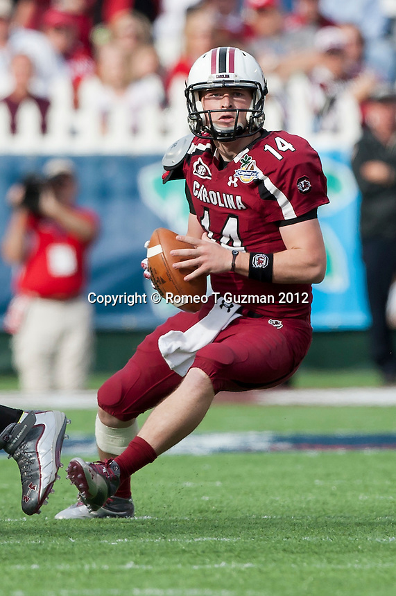 January 2, 2012: South Carolina Gamecocks quarterback Connor Shaw (14) during second half game action in the Capital One Bowl between the Nebraska Cornhuskers and the South Carolina Gamecocks. South Carolina defeated Nebraska 30-13 at the Citrus Bowl in Orlando, Fl.