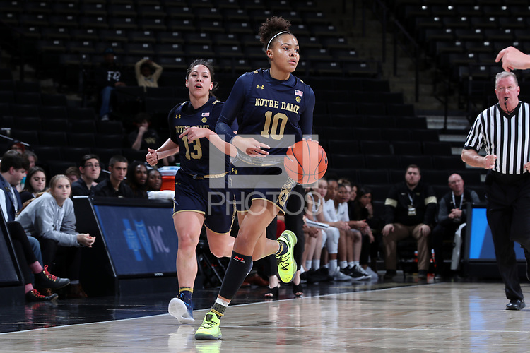 WINSTON-SALEM, NC - FEBRUARY 06: Katlyn Gilbert #10 of the University of Notre Dame brings the ball up the court during a game between Notre Dame and Wake Forest at Lawrence Joel Veterans Memorial Coliseum on February 06, 2020 in Winston-Salem, North Carolina.