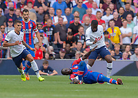 Cheikhou Kouyaté of Crystal Palace injures his ankle from a challenge from Tanguy NDombèlé of Tottenham Hotspur during the Premier League match between Tottenham Hotspur and Crystal Palace at Wembley Stadium, London, England on 14 September 2019. Photo by Vince  Mignott / PRiME Media Images.