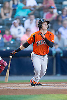 Mike Yastrzemski (4) of the Bowie Baysox follows through on his swing against the Richmond Flying Squirrels at The Diamond on May 23, 2015 in Richmond, Virginia.  The Baysox defeated the Flying Squirrels 3-2.  (Brian Westerholt/Four Seam Images)