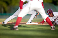 STANFORD, CA - May 10, 2011: Tyler Gaffney of Stanford baseball slides back to first on a pickoff attempt during Stanford's game against Arizona at Sunken Diamond. Stanford won 1-0.