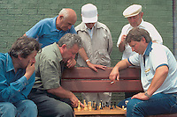 (950601-SWR07) BROOKLYN, NEW YORK -- File Photo -- A group of  Russian Emigrees play a game of chess on the boardwalk at Brighton Beach..Photo  © Stacy Walsh Rosenstock