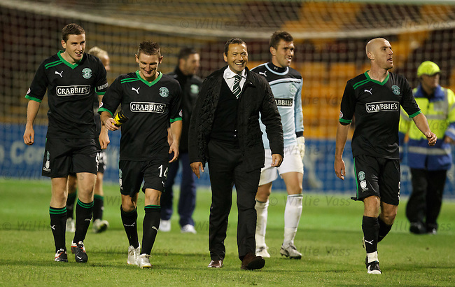 Colin Calderwood walks off happy with his Hibs players after winning the penalty shootout