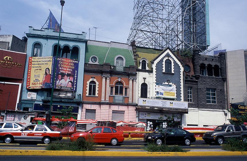 A mishmash of architectural styles clashing on Avenida Insurgentes.  Mexico City 03-13-06
