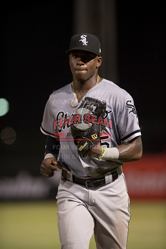 Center fielder Luis Robert (15), on rehab assignment with the AZL White Sox, jogs off the field between innings of an Arizona League game against the AZL Angels at Tempe Diablo Stadium on August 3, 2018 in Tempe, Arizona. The AZL White Sox defeated the AZL Angels 6-4. (Zachary Lucy/Four Seam Images)