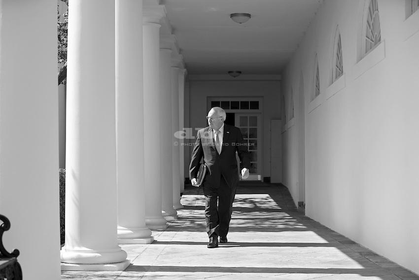 VP Cheney:  Walks alone. West Colonnade.