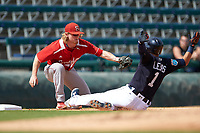 Florida Southern Moccasins third baseman Mitch Reeves (34) looks to tag Jose Iglesias (1) sliding into third base during an exhibition game against the Detroit Tigers on February 29, 2016 at Joker Marchant Stadium in Lakeland, Florida.  Detroit defeated Florida Southern 7-2.  (Mike Janes/Four Seam Images)