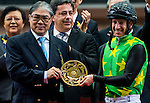 HONG KONG - MAY 04: (R) Timothy Fok give the trophy to (L) Anton Marcus of South Africa after wining The Champions Mile at Sha Tin racecourse on May 4, 2014 in Hong Kong, Hong Kong.  Photo by Aitor Alcalde / Power Sport Images