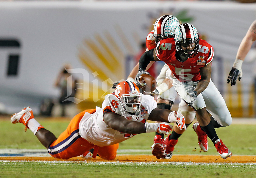Ohio State Buckeyes quarterback Braxton Miller (5) gets by Clemson Tigers defensive tackle D.J. Reader (48) in the 2nd quarter of their game against Clemson Tigers in the Discover Orange Bowl at Sun Life Stadium in Miami Gardens, Florida on January 3, 2014.(Dispatch photo by Kyle Robertson)