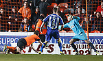 Jon Daly heads in the equaliser past Cammy Bell