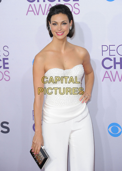 Morena Baccarin.The 2013 People's Choice Awards held at Nokia Live in Los Angeles, California 9th January 2013                                                                   .half length strapless white trousers jumpsuit hand on hip clutch bag silver black .CAP/DVS.©DVS/Capital Pictures.