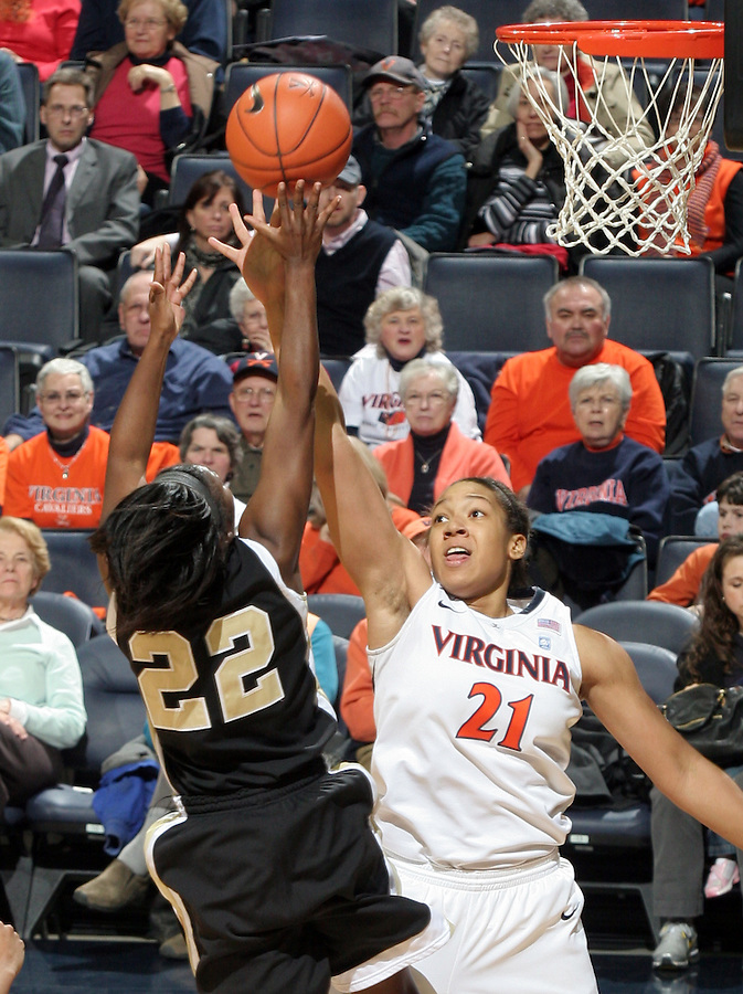 Feb. 3, 2011; Charlottesville, VA, USA; Wake Forest Demon Deacons guard Lakevia Boykin (22) shoots over Virginia Cavaliers forward Jazmin Pitts (21) during the game at the John Paul Jones Arena. Virginia won 73-46. Mandatory Credit: Andrew Shurtleff