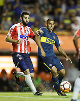 "BUENOS AIRES - ARGENTINA - 04 - 04 - 2018: Ramon Abila (Der.) jugador de Boca Juniors disputa el balón con Jonathan Avila (Izq.) jugador de Atletico Junior, durante partido de la fase de grupos, grupo H, fecha 2, entre Boca Juniors (ARG) y Atletico Junior (Col) por la Copa Conmebol Libertadores 2018, jugado en el estadio Alberto J. Armando ""La Bombonera""  de la ciudad Ciudad Autónoma de Buenos Aires. / Ramon Abila (R) player of Boca Juniors vies for the ball with Jonathan Avila (L) player of Atletico Junior, during a match of the groups phase, group H, of the 2nd date between Boca Juniors (ARG) and Atletico Junior (Col), for the Copa Conmebol Libertadores 2018 at the Alberto J. Armando ""La Bombonera"" Stadium in Ciudad Autónoma de Buenos Aires. Photo: VizzorImage / Javier Garcia Martino / Photogamma / Cont."