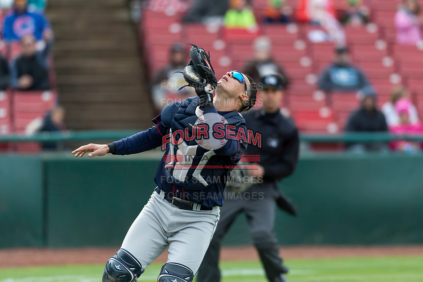 Cedar Rapids Kernels catcher Ben Rodriguez (23) prepares to catch a pop fly in foul territory during a Midwest League game against the Kane County Cougars at Northwestern Medicine Field on April 28, 2019 in Geneva, Illinois. Kane County defeated Cedar Rapids 3-2 in game one of a doubleheader. (Zachary Lucy/Four Seam Images)