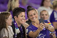 Orlando, FL - Saturday June 03, 2017: Ali Krieger takes a selfie with a fan during a regular season National Women's Soccer League (NWSL) match between the Orlando Pride and the Boston Breakers at Orlando City Stadium.