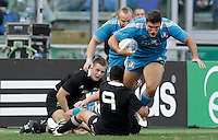 Rugby: test match Italia vs Nuova Zelanda. Roma, stadio Olimpico, 17 novembre 2012..Italy's Tommaso Benvenuti, right, is tackled by New Zealand's Aaron Smith during an international rugby test match between Italy and New Zealand at Rome's Olympic stadium, 17 November 2012..UPDATE IMAGES PRESS/Riccardo De Luca