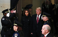 U.S. President Donald Trump and First Lady Melania Trump arrive to pay their respects at the casket of former U.S. President George H.W. Bush as it lies in state inside the U.S. Capitol Rotunda on Capitol Hill in Washington, U.S., December 3, 2018. <br /> CAP/MPI/RS<br /> &copy;RS/MPI/Capital Pictures