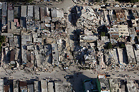 The downtown core shows the damage after an earthquake measuring 7 plus on the Richter scale rocked Port au Prince Haiti just before 5 pm yesterday, January 12, 2009.