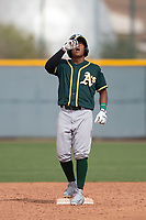 Oakland Athletics shortstop Brallan Perez (28) celebrates hitting a double during a Minor League Spring Training game against the Chicago Cubs at Sloan Park on March 13, 2018 in Mesa, Arizona. (Zachary Lucy/Four Seam Images)
