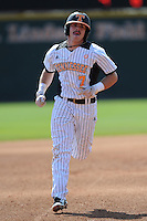 Chris Fritts #7 of the Tennessee Volunteers heads for third at Lindsey Nelson Stadium against the the Manhattan Jaspers on March 12, 2011 in Knoxville, Tennessee.  Tennessee won the first game of the double header 11-5.  Photo by Tony Farlow / Four Seam Images..