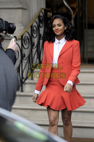 Alesha Dixon.Seen leaving her hotel to go Britain's Got Talent auditions, London, England, UK, 23rd January 2013..half length red orange flared skirt jacket white shirt retro .CAP/IA.©Ian Allis/Capital Pictures.