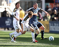 Brian Carroll#7 of the Philadelphia Union pushes past Eric Hassli#29 of the Vancouver Whitecaps during an MLS match at PPL Park in Chester, PA. on March 26 2011. Union won 1-0.